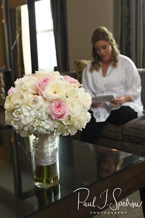 Sarah reads a letter from Anthony during her bridal prep session at The Omni Hotel in Providence, Rhode Island prior to her October 2018 wedding.