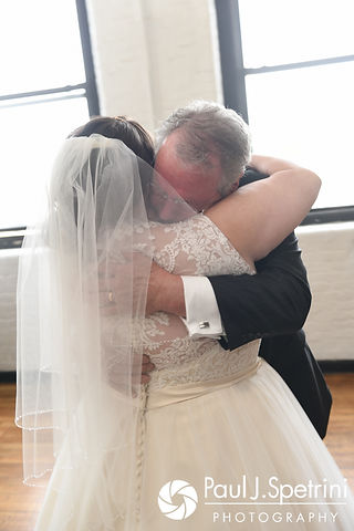 Meridith and her father share a hug during their 'First Look' prior to her May 2017 wedding ceremony at the Hope Artiste Village in Pawtucket, Rhode Island.