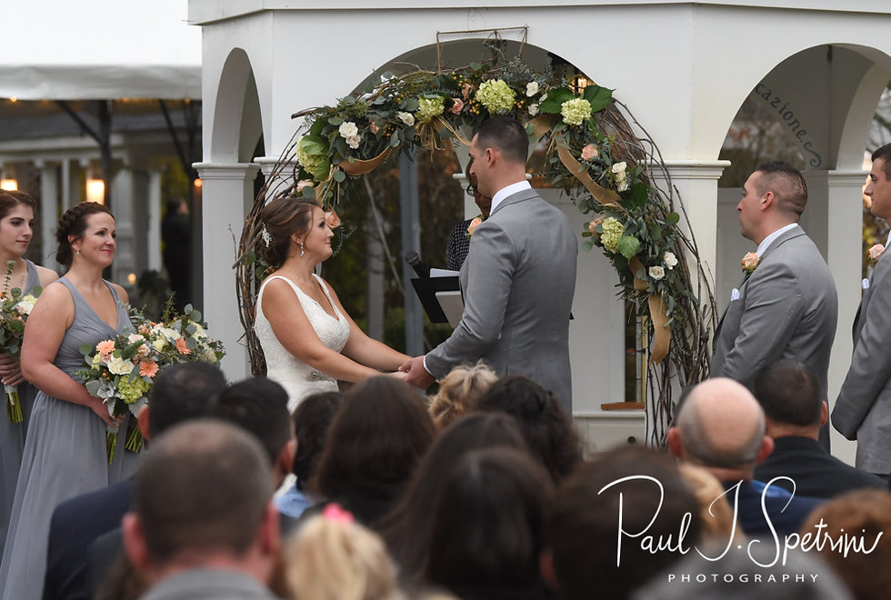 Amanda and Justin hold hands during their November 2018 wedding ceremony at Five Bridge Inn in Rehoboth, Massachusetts.
