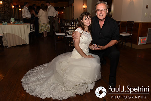 Krystal smiles for a photo during her May 2016 wedding reception at DeWolf Tavern in Bristol, Rhode Island.