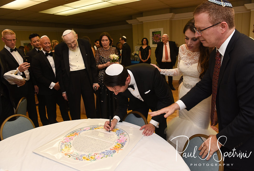 Mike signs the ketubah prior to his September 2018 wedding ceremony at the Touro Synagogue in Newport, Rhode Island.