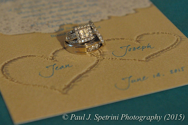 Joe and Jean Andrade's wedding rings and invitation.