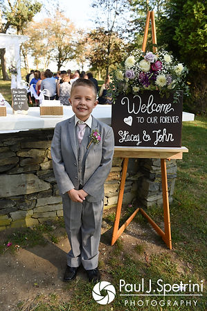Stacey and John's son poses for a photo prior to his parents' September 2017 wedding ceremony at Colt State Park in Bristol, Rhode Island.