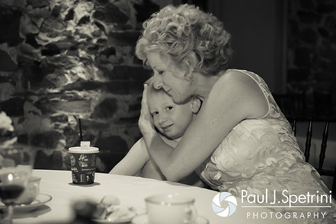 Debbie shares a moment with her grandson during her and Bob's June 2016 wedding reception at DeWolf Tavern in Bristol, Rhode Island.