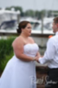 Samantha & Kyle exchange vows during their June 2018 wedding ceremony at Chelo's Waterfront Bar & Grille in Warwick, Rhode Island.