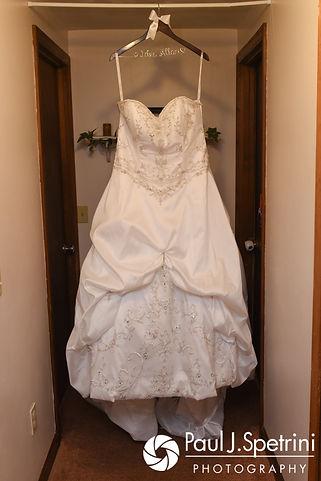 Clarissa's wedding dress hangs prior to her June 2017 wedding ceremony at Twelve Acres in Smithfield, Rhode Island.