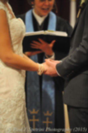 Mike and Emma hold hands during their November 2015 wedding at the Publick House in Sturbridge, Massachusetts.