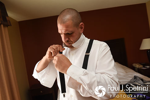 Kevin adjusts his suspenders prior to his September 2017 wedding ceremony at Allen Hill Farm in Brooklyn, Connecticut.