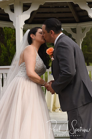 Stephanie and Jacob kiss during their June 2018 wedding ceremony at Foster Country Club in Foster, Rhode Island.