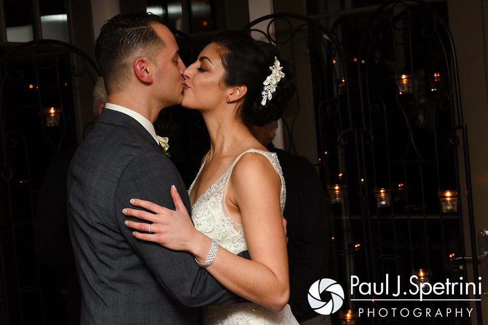 Gina and David kiss during following their December 2016 wedding ceremony at the Waterman Grille in Providence, Rhode Island.