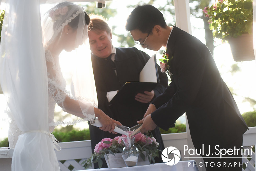 Cynthia and Ao perform a sand ceremony during their August 2017 wedding ceremony at Lake Pearl in Wrentham, Massachusetts.