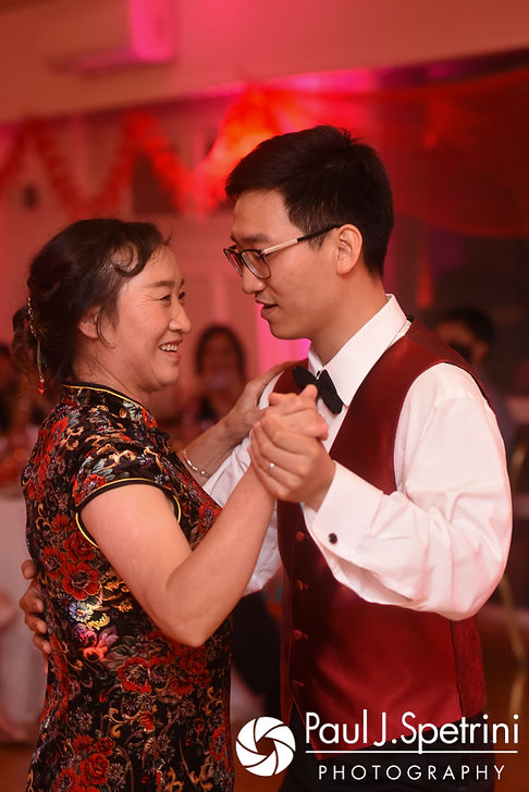Ao and his mother dance during his August 2017 wedding reception at Lake Pearl in Wrentham, Massachusetts.