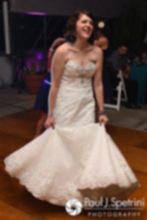 Jen smiles during her September 2016 wedding reception at the Roger Williams Park Botanical Center in Providence, Rhode Island.
