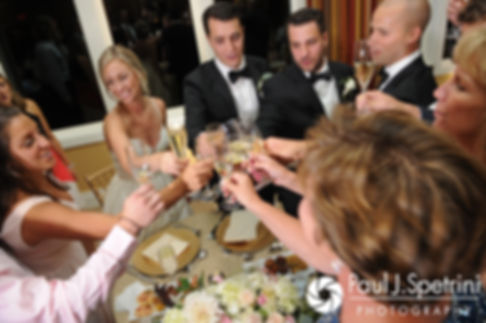 Laura and Laki toast with guests during their September 2017 wedding reception at Lake of Isles Golf Club in North Stonington, Connecticut.