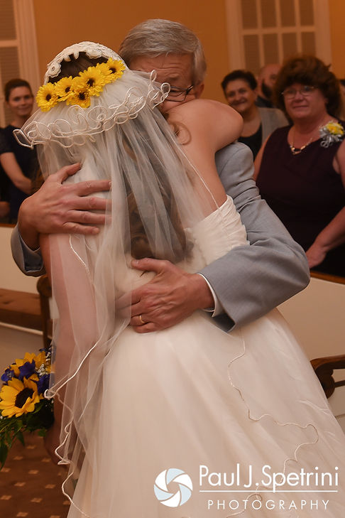 Kristin's father hugs her during her October 2016 wedding ceremony at the Exeter Congregational Church in Exeter, New Hampshire.