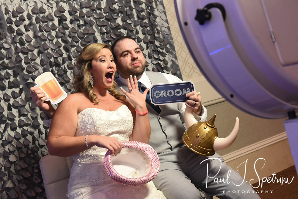 Sarah & Anthony pose for a photobooth photo during their October 2018 wedding reception at The Omni Hotel in Providence, Rhode Island.
