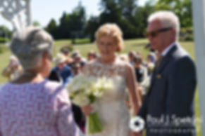 Bob and Debbie join hands during their June 2016 wedding in Barrington, Rhode Island.