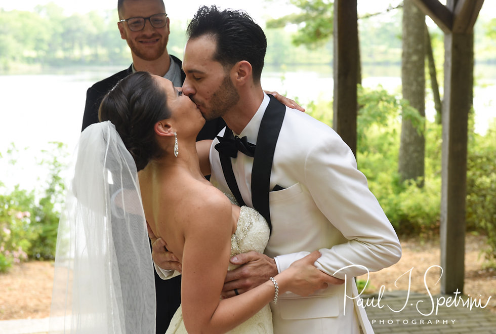 Kendra and Joe kiss during their May 2018 wedding ceremony at Crystal Lake Golf Club in Mapleville, Rhode Island.