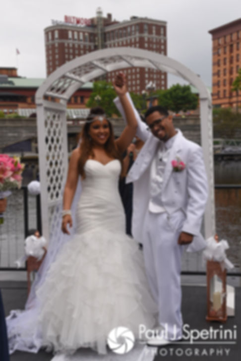 Lucelene and Luis celebrate their marriage during their June 2017 wedding ceremony at Waterplace Park in Providence, Rhode Island.