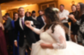 Katie dances with guests during her October 2018 wedding reception at The Villa at Ridder Country Club in East Bridgewater, Massachusetts.