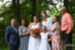 Samantha and Kyle pose for a formal photo with their families at Goddard Park in East Greenwich, Rhode Island prior to their June 2018 wedding ceremony.