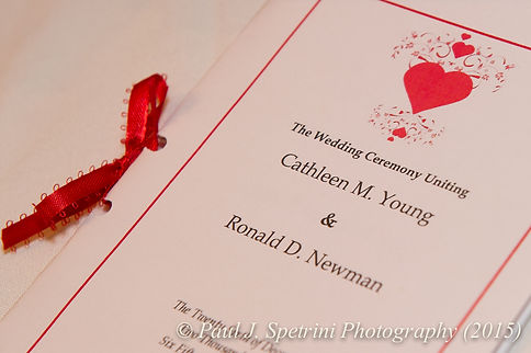 Cathy and Ron's wedding invitation during their December 2015 Rhode Island wedding at Quidnessett Country Club in North Kingstown, Rhode Island.