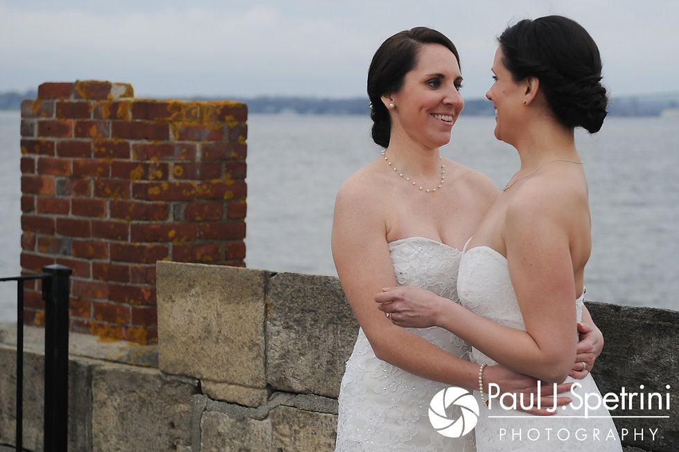 Caroline and Morgan pose for a formal photo during their April wedding at the Fort Adams Trust in Newport, Rhode Island.