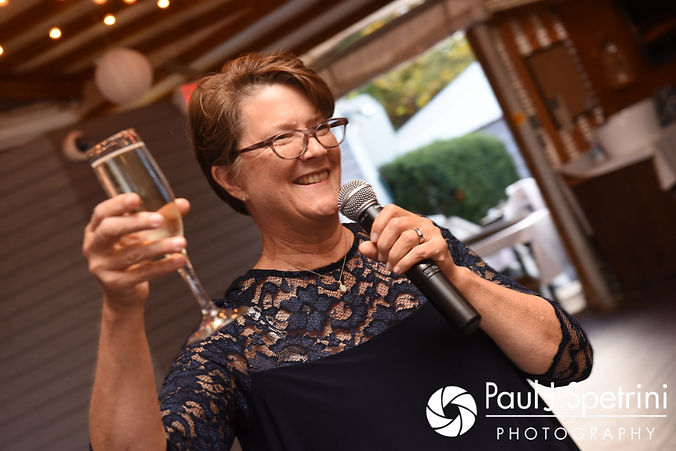 Rachel's mother gives a toast during Mike and Rachel's October 2017 wedding reception at Castle Manor Inn in Gloucester, Massachusetts.