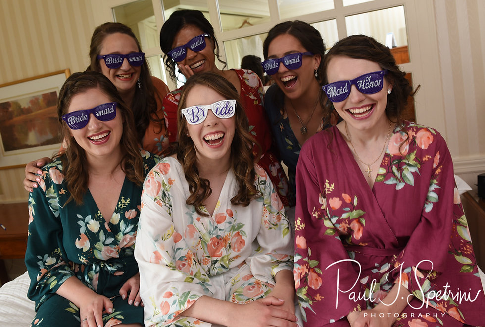 Sarah and her bridesmaids pose for a photo prior to her June 2018 wedding ceremony at the College of the Holy Cross in Worcester, Massachusetts.