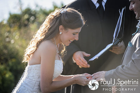 Marissa laughs while putting on Paul's ring during her September 2016 wedding ceremony at Beavertail Lighthouse in Jamestown, Rhode Island.