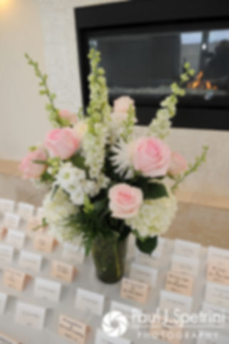 A look at the seating chart and flowers on display during Nashua and Nader's July 2017 wedding reception at Belle Mer in Newport, Rhode Island.