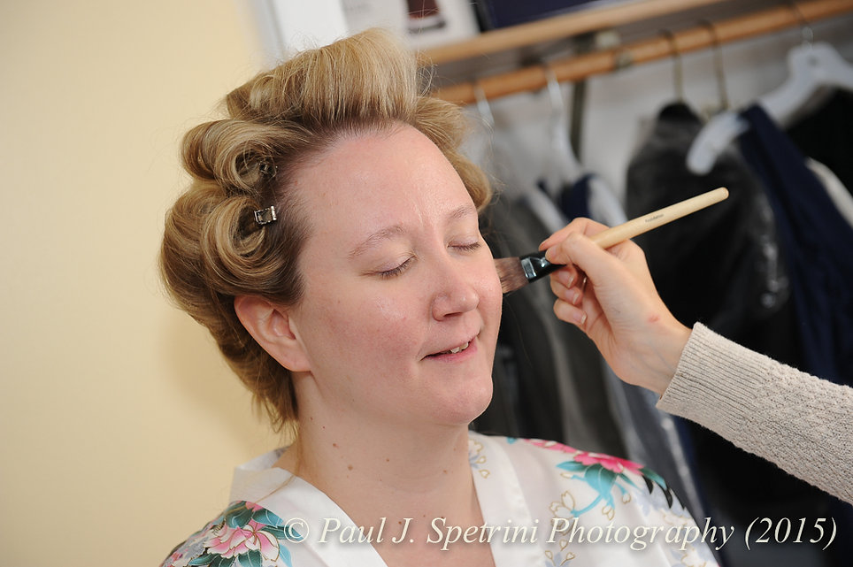 Kerry gets her makeup applied prior to her fall wedding at Quidnessett Country Club in North Kingstown, Rhode Island on October 23rd, 2015.