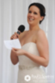 Morgan reads her vows to Caroline during her April wedding ceremony at the Fort Adams Trust in Newport, Rhode Island.