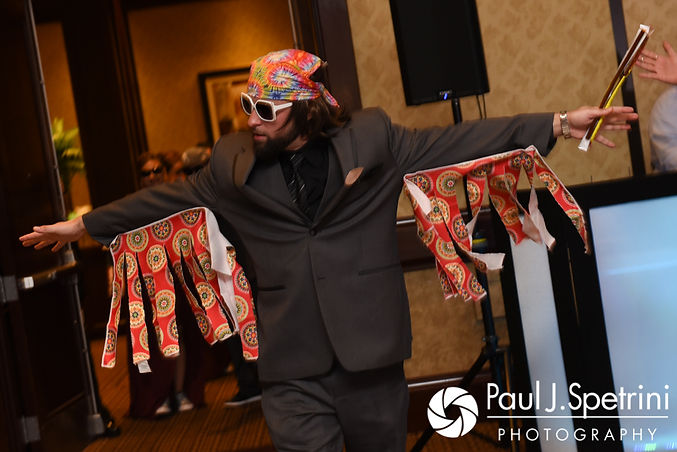 A groomsmen enters the room during Dallas and Nicky's September 2017 wedding reception at the Crowne Plaza Hotel in Warwick, Rhode Island.