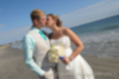Lisa and Jason kiss during a formal portrait session during their September 2015 Rhode Island Wedding at the Galilee Beach Club in Narragansett, RI.