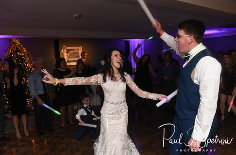 Stacey & Mack dance with guests during their December 2018 wedding reception at Independence Harbor in Assonet, Massachusetts.