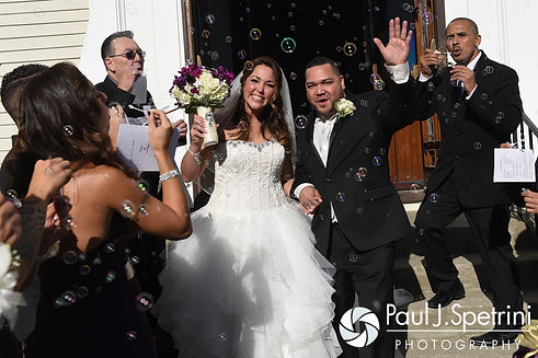 Stephanie and Henry greet their guests following their October 2016 wedding ceremony at the Historic St. Joseph Church in Cumberland, Rhode Island.