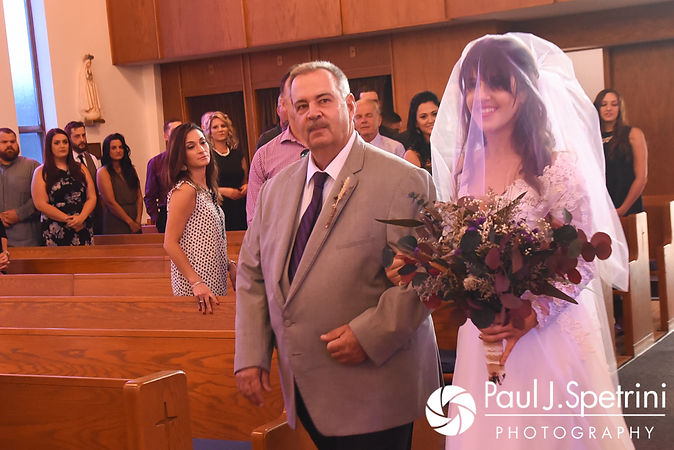 Samantha and her father walk down the aisle during her October 2017 wedding ceremony at St. Robert's Church in Johnston, Rhode Island.