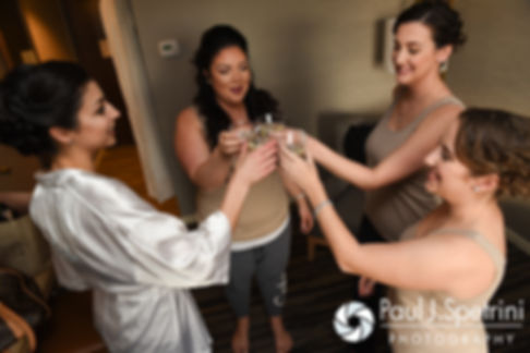 Gina and her bridesmaid share a toast prior to her December 2016 wedding ceremony at the Waterman Grille in Providence, Rhode Island.