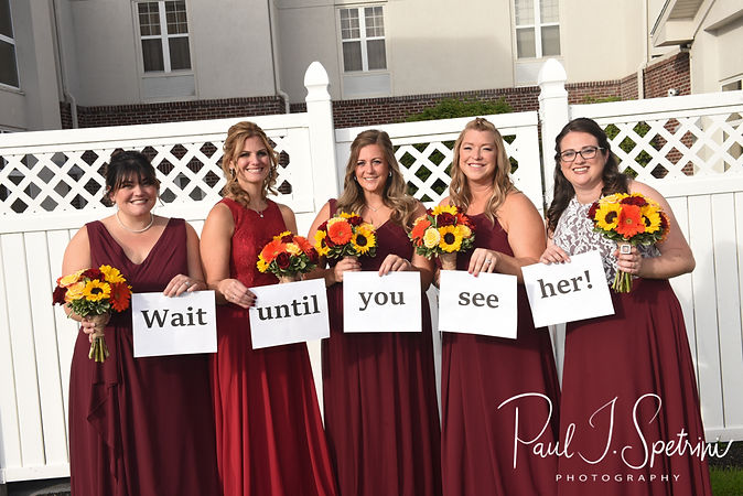 Justine's bridesmaids hold a sign for the brde prior to her October 2018 wedding ceremony at Twelve Acres in Smithfield, Rhode Island.