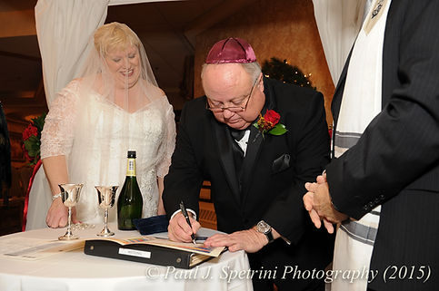 Ron signs the ketubah and he and Cathy's December 2015 wedding at Quidnessett Country Club in North Kingstown, Rhode Island.