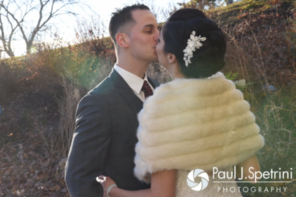 Gina and David kiss during their first look prior to his December 2016 wedding ceremony at the Waterman Grille in Providence, Rhode Island.
