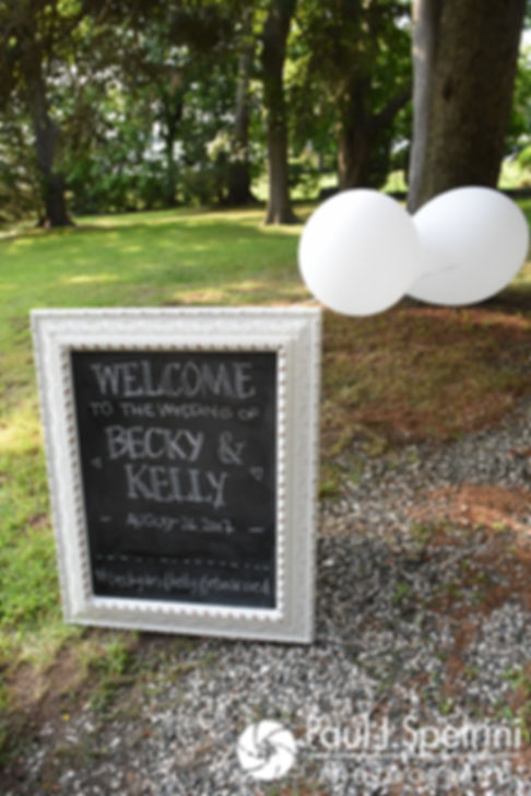 A sign on display welcomes guests prior to Rebecca and Kelly's August 2017 wedding ceremony in Warwick, Rhode Island.