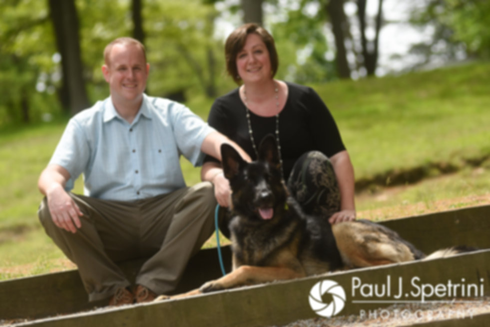 Ashley and Robert pose with their dog for a photo at Roger Williams Park during their May 2017 engagement photo session.