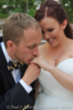 William and Meg pose for a photo during their July 2014 wedding.