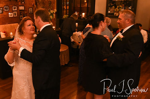 Patti & Bob dance with guests during their August 2018 wedding reception at the Olde Colonial Cafe in Norwood, Massachusetts.