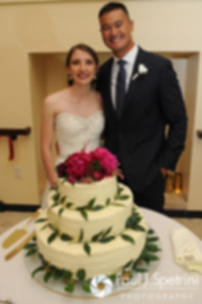 Dan and Simonne stand near their wedding cake during their June 2016 wedding in Providence, Rhode Island.