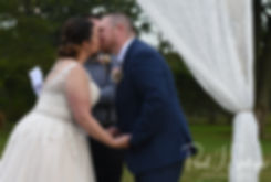 Adam and Ashley kiss during their September2018 wedding ceremony at Stepping Stone Ranch in West Greenwich, Rhode Island.