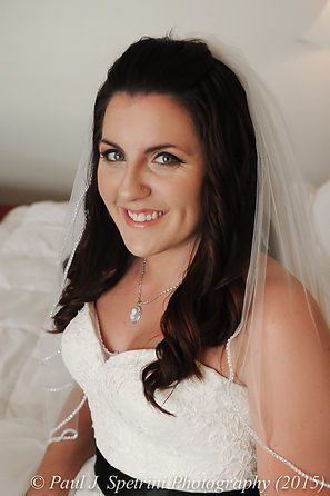 Jamie Bolani smiles for bridal portraits on the date of her wedding in June 2015.