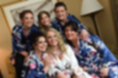 Michelle and her bridesmaids pose for a photo during her bridal prep session prior to her May 2016 wedding at Hillside Country Club in Rehoboth, Massachusetts.